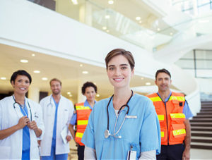 This is a group of medical professionals standing in a group in a brightly lit lobby.