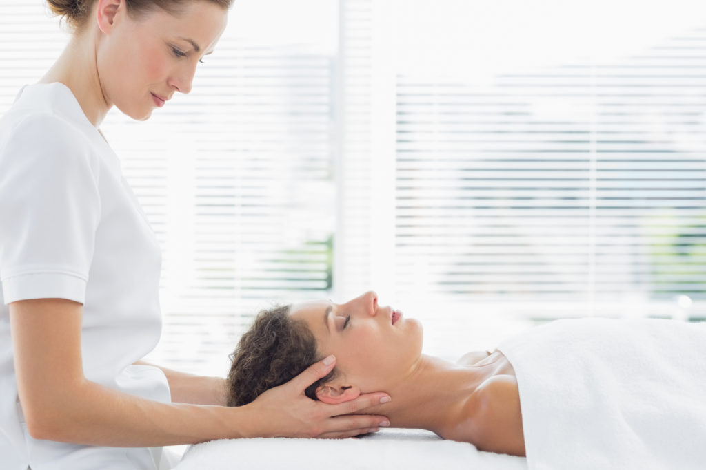 blonde physio treating neck